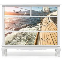 Naklejka na meble - Yacht sailing towards the sunset. Sailing. Luxury yachts.