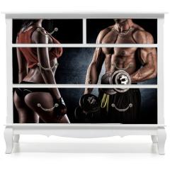 Naklejka na meble - Closeup of a muscular young man lifting weights