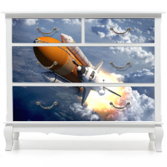 Naklejka na meble - Space Shuttle Flying Over The Clouds