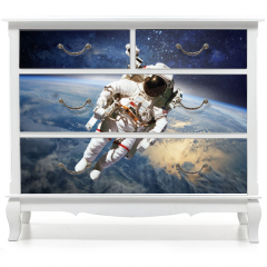 Naklejka na meble - Astronaut in outer space with planet earth as backdrop. Elements