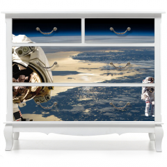 Naklejka na meble - A team of astronauts performing work on a space station.- Elements of this image furnished by NASA.