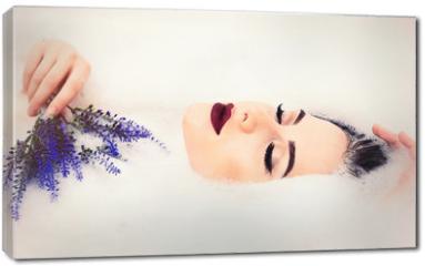 Obraz na płótnie canvas - woman with flowers in the foam bath