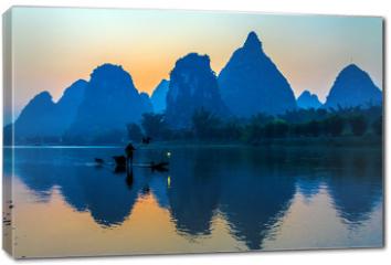Obraz na płótnie canvas - Silhouette of Fisherman with Cormorant Bird on Boat China River