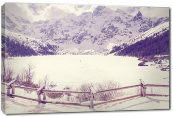 Obraz na płótnie canvas - Vintage stylized frozen lake Morskie Oko in Tatra Mountains, most popular mountain lake in Poland.