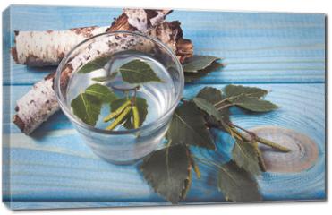 Obraz na płótnie canvas - A glass of birch juice on wooden background