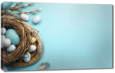 Obraz na płótnie canvas -  Easter background with Easter eggs and spring flowers on blue table