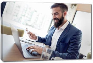 Obraz na płótnie canvas - Business man working with documents and laptop