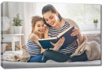 Obraz na płótnie canvas - Mom and child reading a book