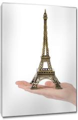 Obraz na płótnie canvas - Paris Eiffel tower souvenir in hand