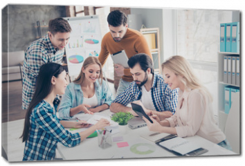 Obraz na płótnie canvas - Attractive stylish confident thoughtful positive beautiful handsome financiers students having training seminar expertising analyzing new project, start up in office with modern interior