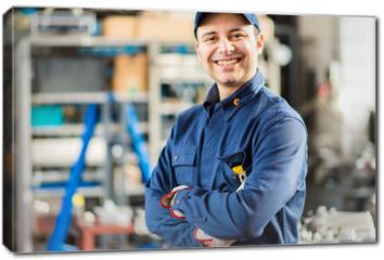 Obraz na płótnie canvas - Smiling mechanic portrait