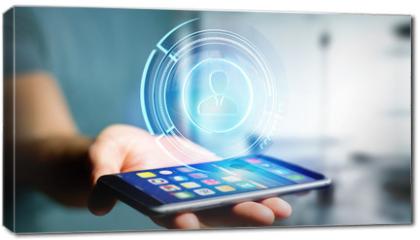Obraz na płótnie canvas - Businessman using a smartphone with a Shinny technologic network contact button  - 3d render