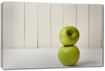 Obraz na płótnie canvas - Two raw fresh green apples on wooden background with copy space