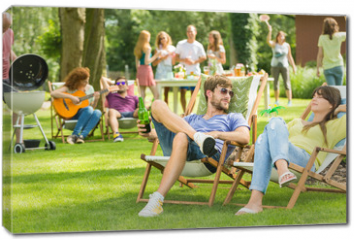 Obraz na płótnie canvas - Young friends having barbecue picnic