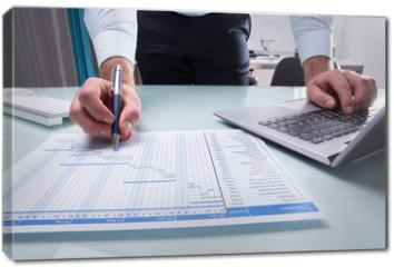 Obraz na płótnie canvas - Businessperson Working On Gantt Chart