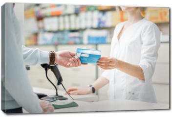Obraz na płótnie canvas - Giving madication at the pharmacy counter