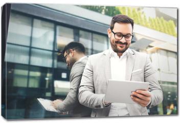 Obraz na płótnie canvas - Businessman using tablet