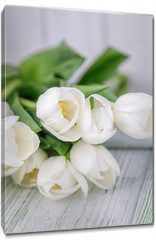 Obraz na płótnie canvas - Beautiful white tulips on a light wooden background. Free space