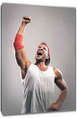 Obraz na płótnie canvas - Athlete with a raised hand celebrates victory