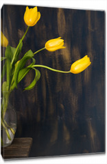 Obraz na płótnie canvas - Yellow Tulips in glass vase on Blue background