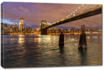 Obraz na płótnie canvas - Skyline of New York and Brooklyn bridge at night, New York, USA