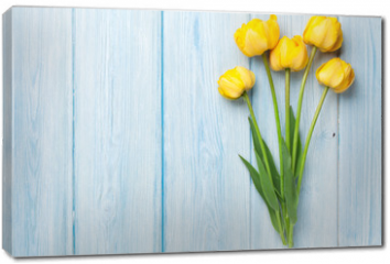 Obraz na płótnie canvas - Yellow tulips on wooden table