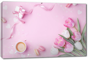 Obraz na płótnie canvas - Morning cup of coffee, cake macaron, gift or present box and spring tulip flowers on pink background. Beautiful breakfast for Women day, Mother day. Flat lay.