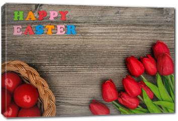 Obraz na płótnie canvas - Easter eggs and red tulips