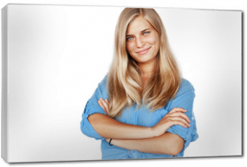 Obraz na płótnie canvas - Young beautiful girl woman blond with long hair and blue eyes in a blue shirt isolated white background