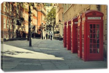 Obraz na płótnie canvas - Street with a Tradicional Red Phone Boxes, London.