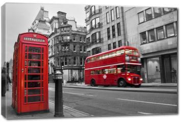 Obraz na płótnie canvas - Cabine téléphonique et bus rouges à Londres (UK)
