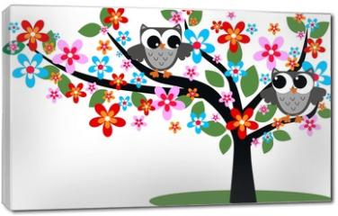 Obraz na płótnie canvas - two owls sitting in a tree