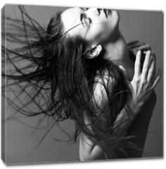 Obraz na płótnie canvas - A beautiful girl is posing