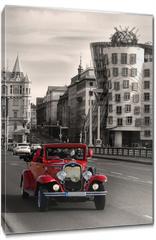 Obraz na płótnie canvas - Red beautiful vintage cars in Prague