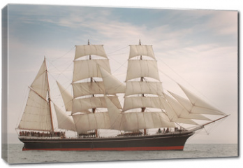 Obraz na płótnie canvas - Vintage windjammer style ship with full sails on the open sea