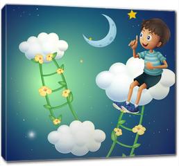 Obraz na płótnie canvas - A boy sitting at the cloud