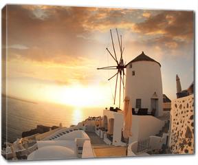 Obraz na płótnie canvas - Windmill in Santorini against sunset, Greece