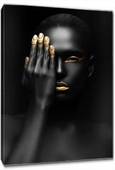 Obraz na płótnie canvas - dark-skinned woman with golden make-up.
