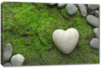 Obraz na płótnie canvas - Grey stone in shape of heart, on grass background