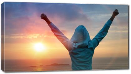 Obraz na płótnie canvas - Sport success on sunset background