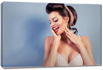 Obraz na płótnie canvas - Beauty smiling pinup girl on blue wall
