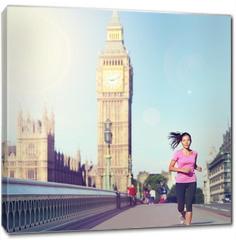 Obraz na płótnie canvas - London woman running Big Ben - England lifestyle
