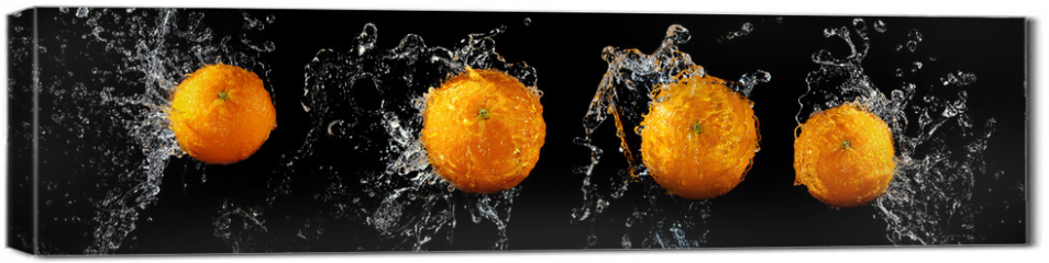 Obraz na płótnie canvas - Set of fresh oranges in water splash
