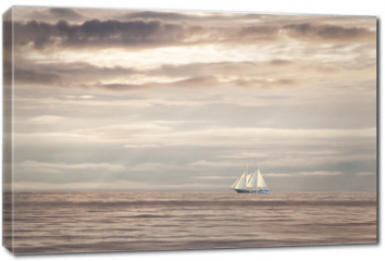 Obraz na płótnie canvas - Dreams and freedom... Sailboat on the open sea at sunset.