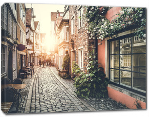 Obraz na płótnie canvas - Historic street in Europe at sunset with retro vintage effect