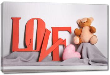 Obraz na płótnie canvas - Decorative letters forming word LOVE with teddy bear