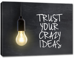 Obraz na płótnie canvas - Light bulb lamp on blackboard background with idea quote