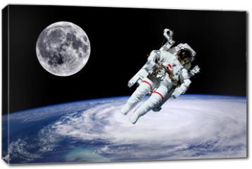 Obraz na płótnie canvas - Astronaut Earth Moon Space