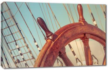 Obraz na płótnie canvas - Steering wheel of old sailing vessel