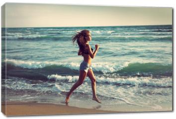 Obraz na płótnie canvas - active on beach